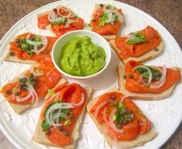 Smoked salmon, sour dough bread, garlic butter,  sliced onion, capers, basil leaves, guacamole.