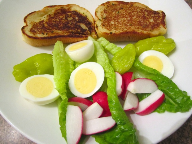 Garlic bread, hard boiled eggs, romaine, radish, pickled chilies, drizzled with lemon vinaigrette