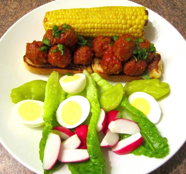 "Lamb meatball sandwich with buttered corn and ""stuff"""