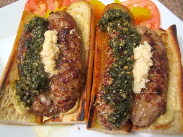 Add grilled/butterflied chorizo, tomato, banana peppers, horseradish and chimichurri