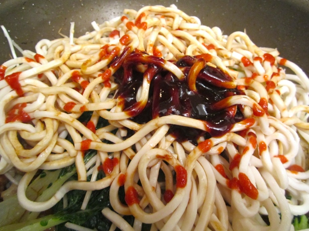 Add freshly cooked and drained udon noodles, hoi sin sauce, soy sauce, sriracha and maggi seasoning. mix well.