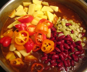 add beans, potatoes and chilies