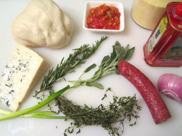 pizza dough, diced salame, spicy tomato salsa, gorgonzola, corn meal, red onion, olive oil, sage, rosemary, thyme, scallion