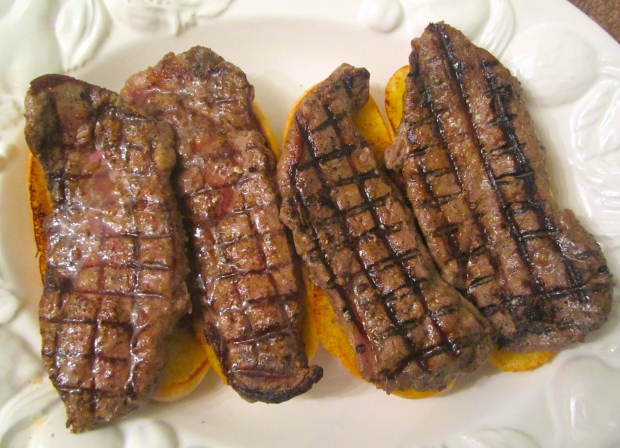 season 16 oz striploin steaks with sea salt and cayenne pepper, grill to desired doneness, top each bread with one steak, top with egg/onion, add banana peppers. Feeds two hungry guy's (Darryl and I :-)
