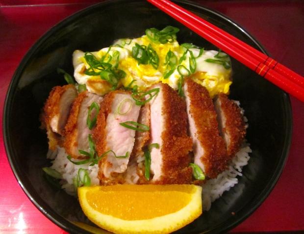 add sliced cutlet, eggs and orange wedge