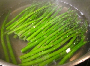 meanwhile, blanch asparagus in generously salted water. Shock in ice water, drain