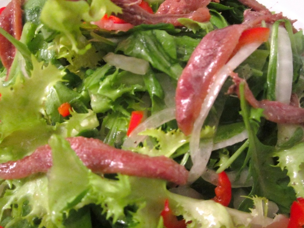 frissee, arugula, onions, chilies and anchovies in dijon vinaigrette