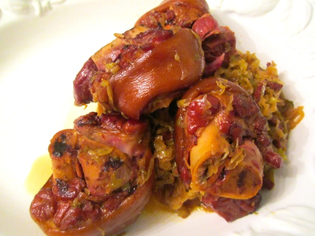 Once the pork knuckles are very tender without falling apart, remove from stock and bury in the cabbage. Let cool and store overnight in fridge. Next day, reheat and serve with sauteed parsley potatoes. Serve with mustard and horseradish