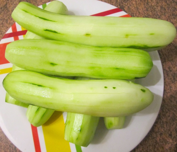 peel cucumbers, slice thin