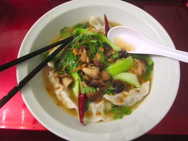 Pork And Spinach Dumplings With Bok Choy And Straw Mushroom In Chili Broth