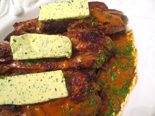 to plate, arrange veal on top of bread, spoon sauce over top, crown wiyh garlic/herb butter