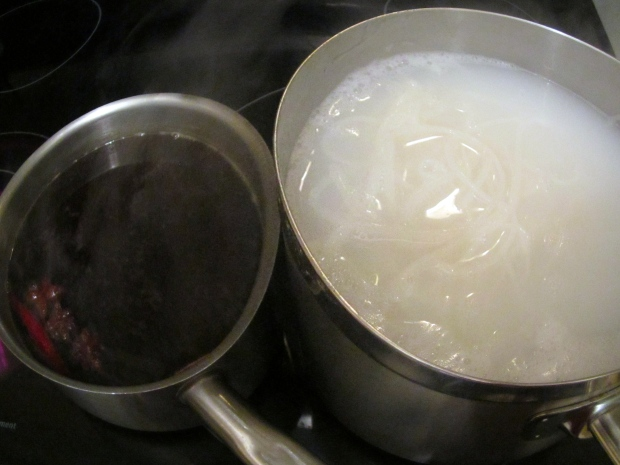 meanwhile, cook rice noodles, drain, rinse with hot water