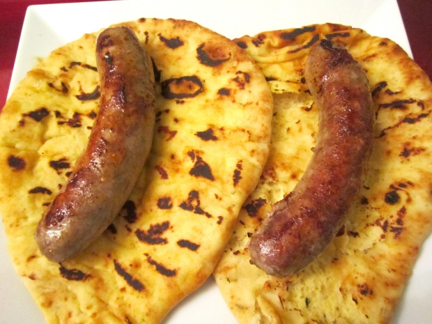 top naan with bratwurst