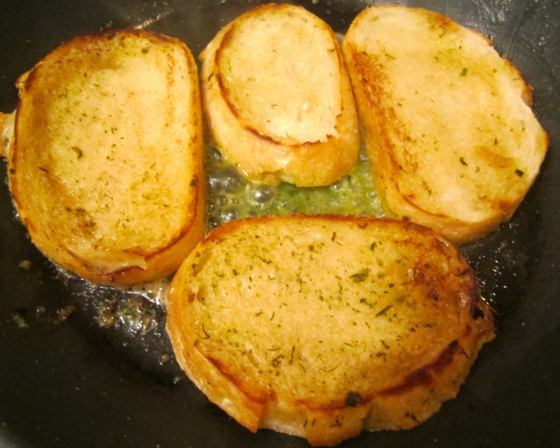 in another pan, saute sour dough bread in garlic butter until golden
