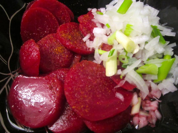 meanwhile, make a salad of red beets, raspberry vinagrette, diced onions and sliced scallions