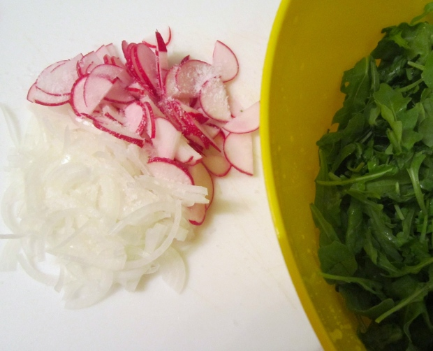 meanwhile, squeeze and discard excess juice from radish and onions, add arugula, white balsamic vinegar, freshly ground white pepper, garlic/olive oil and a splash of maggi seasoning