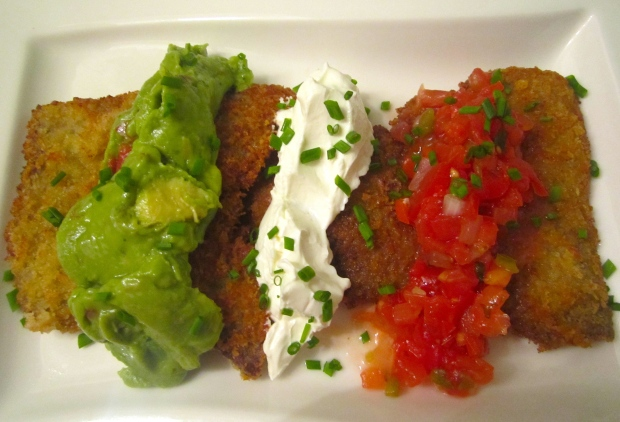 place onto serving platter, drizzle with lime juice, top with guacamole, sour cream and salsa mexicana, sprinkle with chives or cilantro