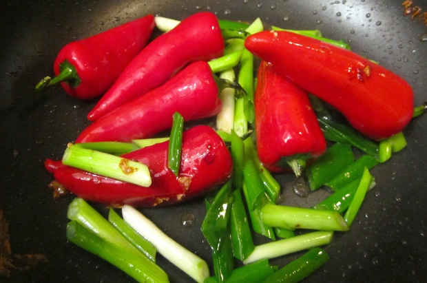saute chilies and scallions, remove from wok, reserve
