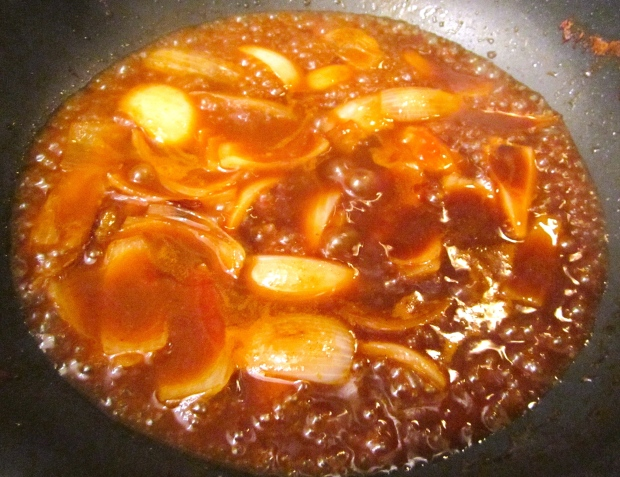 add soy sauce, oyster sauce, chicken stock, sesame oil and sugar, simmer until slightly thickened