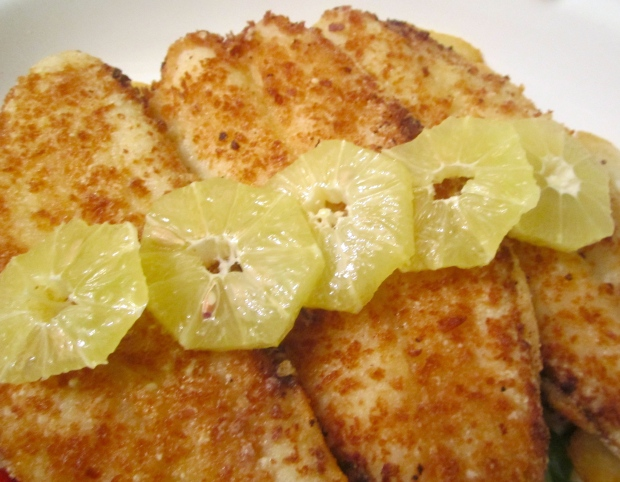 top fish filets with peeled, sliced lemon