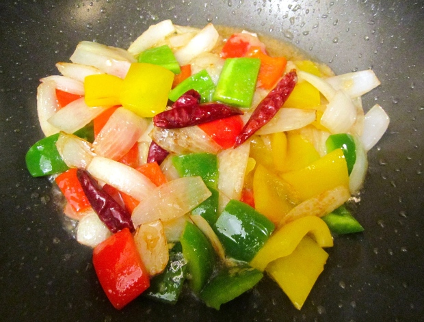 add peppers and scallions, saute for two minutes, add garlic paste and grated ginger, saute until fragrant, remove, reserve