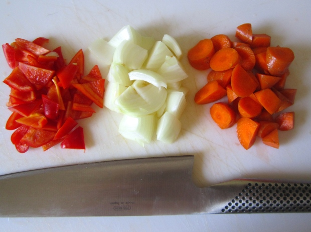 cut mild chilies, onion and blanched carrots into triangels