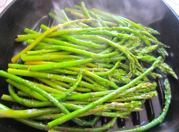 season blanched green asparagus with kosher salt and cayenne pepper, coat in garlic oil, grill until heated through