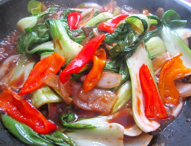 add oyster sauce, soy sauce, sriracha and sesame oil, simmer until bok choy is heated through, check / adjust seasoning