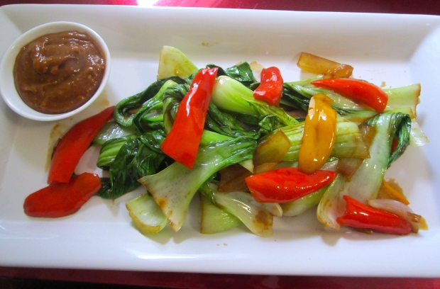 plate bok choy and a small side dish with peanut sauce for dipping