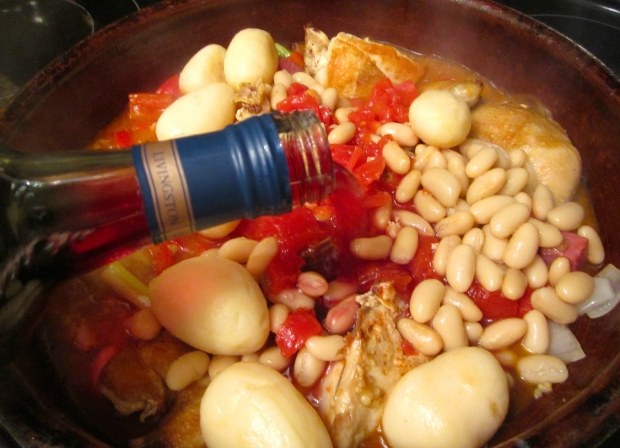 deglaze with merlot, add small blanched potatoes, chopped tomatoes with their juices, cannelini beans and straw mushrooms