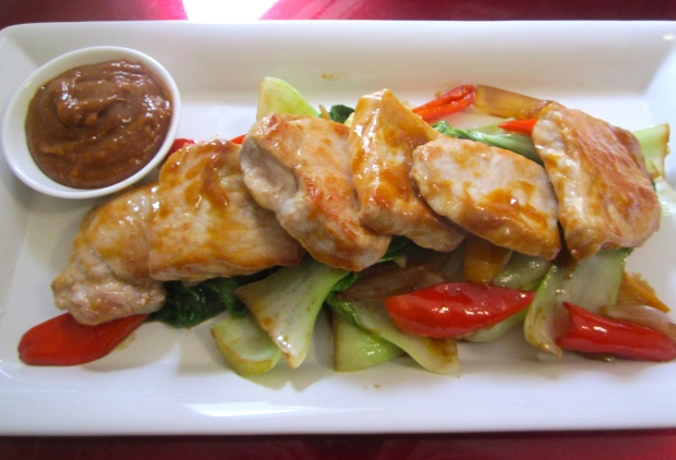 arrange glazed pork medaillons on bok choy