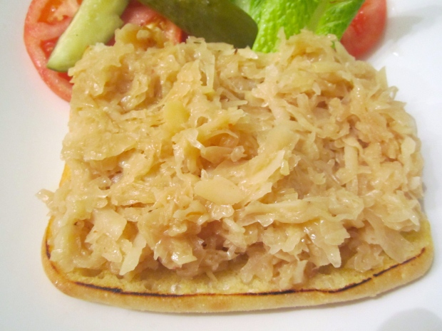 top with fine quality, cooked sauerkraut