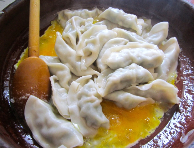 add freshly boiled, drained dumplings (if using leftovers, saute after onions before adding the garlic paste