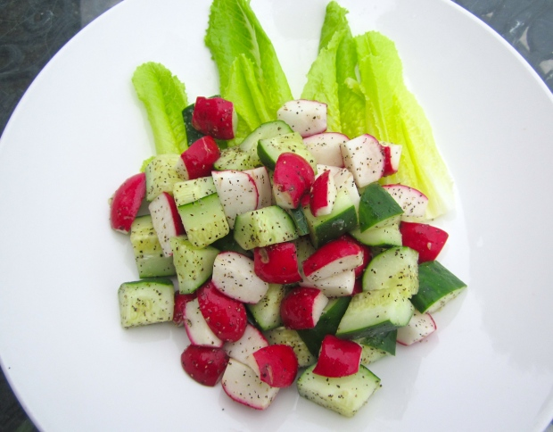 plate salad on vinaigrette dressed romaine