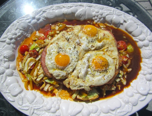 top with fried eggs, serve with horseradish mashed potatoes or a good rustic bread to soak up the sauce and juices