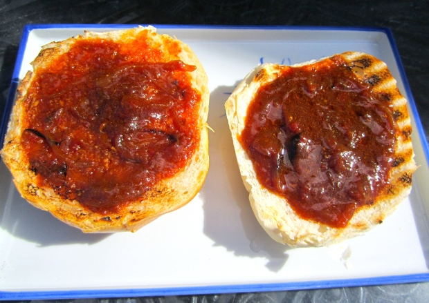 top both halves of buns with onion/sauce