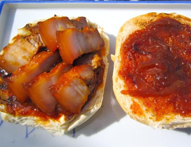 add pork to bottom half of bun