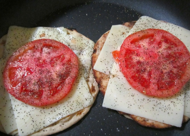 top with sliced tomato, sprinkle with kosher salt and freshly ground black pepper