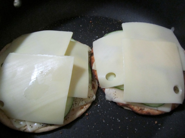 top with pickled cucumber slices(salt, pepper, vinegar) and more emmentaler