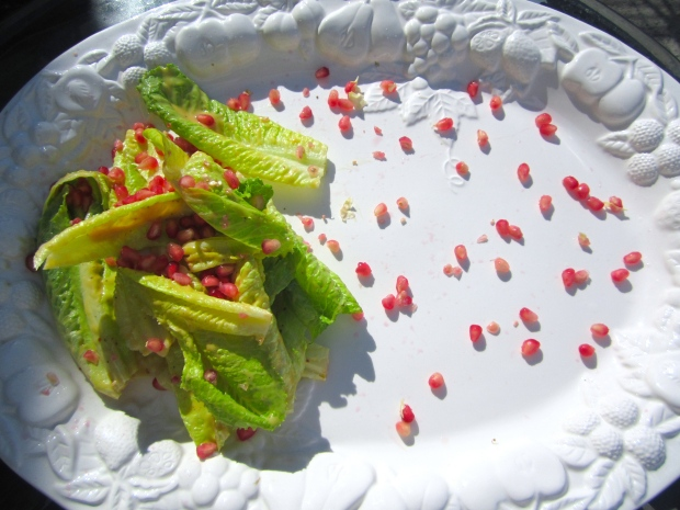 plate salad (romaine in honey/mustard dressing), sprinkle with pomegranate seeds