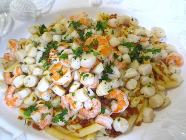 top with seafood, sprinkle with chopped Italian parsley