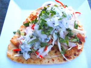 top tzatziki with finely sliced onions and chopped cilantro