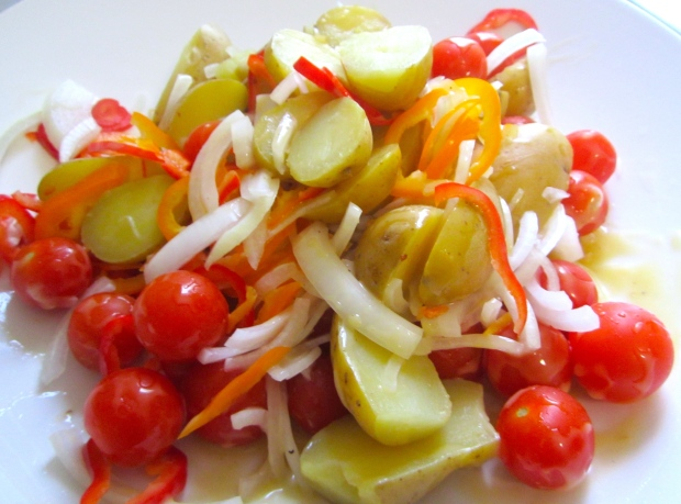 dress grape tomatoes, small, halved potatoes, sliced onions and peppers with dijon vinaigrette