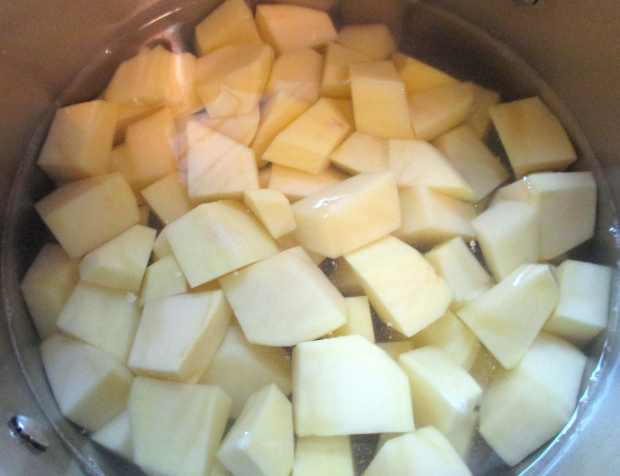 Cook diced potatoes in saltwater until tender, drain, mash