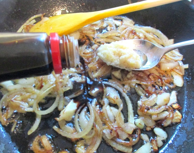 add soy sauce, garlic paste, cayenne pepper and a bit of chicken stock to caramelized onions