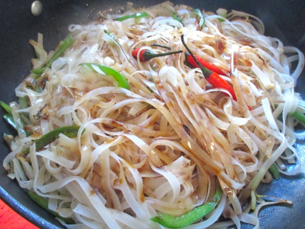 add rice noodles which you had soaked in warm water for 10 minutes then drained, add a small amount of  soy sauce and water, cook until liquid has evaporated