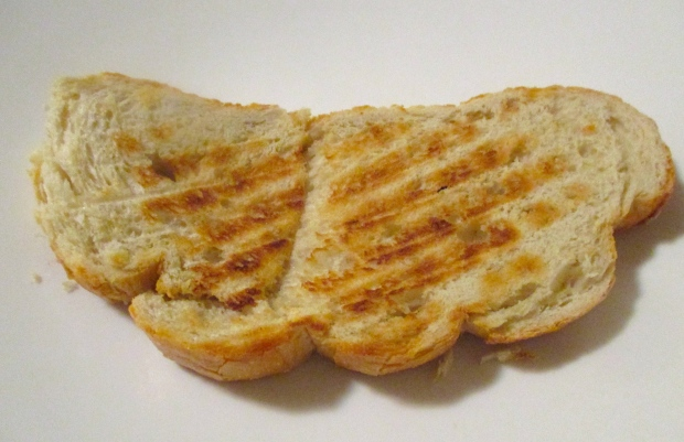plate a thick slice of grilled sour dough bread