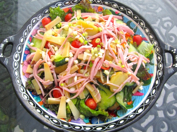 Salad with asiago cheese and bologna in dijon vinaigrette
