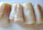 season cod filets with granulated garlic, kosher salt and cayenne pepper, dust with rice flour