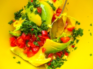 remove avocado flesh, dice tomatoes, chop chilies, chop cilantro, add garlic paste, kosher salt, freshly squeezed lime juice and olive oil, mix well